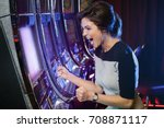 happy woman playing slot... | Shutterstock . vector #708871117