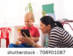young mother and her son play... | Shutterstock . vector #708901087