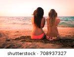 two sexy girls enjoying sitting ... | Shutterstock . vector #708937327
