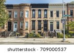 a row of brick apartment... | Shutterstock . vector #709000537
