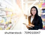 Small photo of Asian Business woman using a tablet and background blur office. Using only modern technology will help ensure that customers receive comprehensive solutions. And better support as soon as possible.