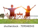 couple sitting at burning camp... | Shutterstock . vector #709048543