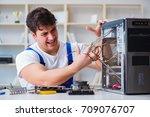 computer repairman repairing... | Shutterstock . vector #709076707