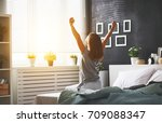 young happy woman woke up in... | Shutterstock . vector #709088347