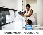 african descent kid helping mom ... | Shutterstock . vector #709089073