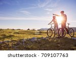 biker couple with mountain bike ... | Shutterstock . vector #709107763