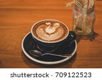 coffee cup and coffee beans on... | Shutterstock . vector #709122523