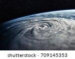 typhoon over planet earth  ... | Shutterstock . vector #709145353
