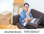 young asian man working at home ...   Shutterstock . vector #709150417