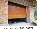 installing garage door in new... | Shutterstock . vector #709158277