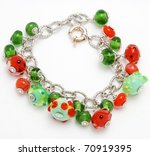 bracelet handmade from Murano glass on a white background - stock photo
