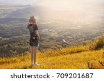 girl with a backpack and a hat... | Shutterstock . vector #709201687