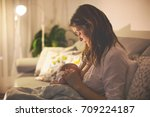 young beautiful mother ... | Shutterstock . vector #709224187