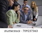 group of pondering skilled... | Shutterstock . vector #709237363