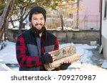 masculine man carrying firewood ... | Shutterstock . vector #709270987