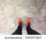 feet and legs on grey floor ... | Shutterstock . vector #709297387