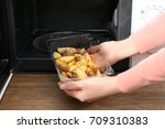 woman putting plastic food... | Shutterstock . vector #709310383