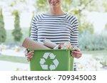 aware woman separating paper... | Shutterstock . vector #709345003