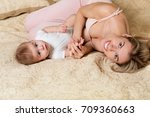 mother and baby playing and... | Shutterstock . vector #709360663