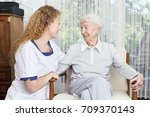 care for senior woman young... | Shutterstock . vector #709370143