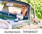 beautiful woman sitting in a...   Shutterstock . vector #709384027
