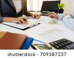 business team meeting... | Shutterstock . vector #709387237