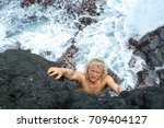 a young climber with long white ... | Shutterstock . vector #709404127