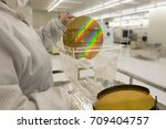 technician in clean white suits ... | Shutterstock . vector #709404757