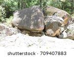 big heavy boulder isolated | Shutterstock . vector #709407883