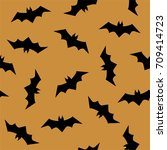vector pattern with bats.... | Shutterstock .eps vector #709414723