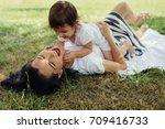 happy caucasian mother and her... | Shutterstock . vector #709416733