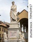 Small photo of Statue of famous italian poet Dante Alighieri in the Piazza di Santa Croce in Florence, Italy