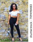 rocker girl on brick wall... | Shutterstock . vector #709498483
