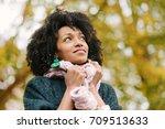 black pensive woman wearing... | Shutterstock . vector #709513633