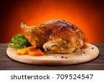 roast chicken on cutting board  | Shutterstock . vector #709524547