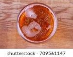 beer on wooden background.... | Shutterstock . vector #709561147