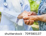 close up medical doctor holding ... | Shutterstock . vector #709580137