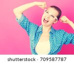 powerful young woman on a pink... | Shutterstock . vector #709587787