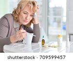 mature woman with thermometer | Shutterstock . vector #709599457