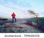 man silhouette on cliff. hiker... | Shutterstock . vector #709630153