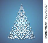 christmas tree cut out of paper.... | Shutterstock .eps vector #709640257