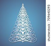 christmas tree cut out of paper.... | Shutterstock .eps vector #709640293