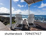 two wooden lounge chairs...   Shutterstock . vector #709657417