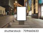 blank street billboard at night ...   Shutterstock . vector #709660633