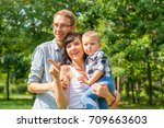 family with a child in the park ...   Shutterstock . vector #709663603