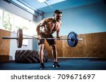 strong bearded tattooed man at... | Shutterstock . vector #709671697