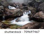 foggy day near waterfall of... | Shutterstock . vector #709697467