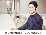 happy indian male student... | Shutterstock . vector #709706977