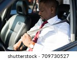man fastening the seatbelt in... | Shutterstock . vector #709730527