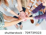 group of young people hands... | Shutterstock . vector #709739323